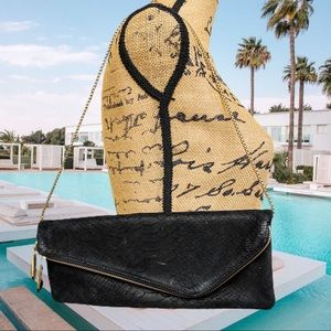 Henri Bendel black leather envelope chain clutch